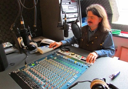 Robbie Sandberg working a mixing desk in a Studio